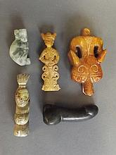 Five Chinese carved hardstone pendants in the form of animals, figures and a phallus, 3¼'' largest