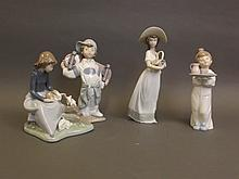 Four Nao pottery figures, 8½'' high