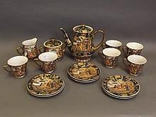 A Japanese Kutani six plate porcelain tea set decorated with sailing barges