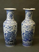 A large pair of Chinese floor vases with blue and white decoration of hawks and finches, 41'' high (one AF, losses to rim)