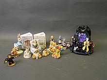 A quantity of cherished teddies, Brambly Hedge money boxes, a Disney musical snow globe, and other Doulton and Wade collectables, some with boxes, globe 9'' high (14)