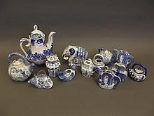 A quantity of C20th Chinese blue and white pottery teapots in various forms etc, 8½'' high