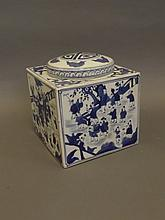 A Chinese blue and white square form porcelain jar and cover with painted decoration depicting boys playing in a garden, 6 character mark, 7'' square, 7½'' high