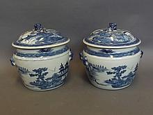 A pair of Chinese blue and white jars and covers decorated with figures and pagodas in a river landscape, 9½'' high