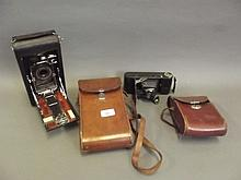 An APM vintage camera and leather case, and a Kodak vintage camera with case