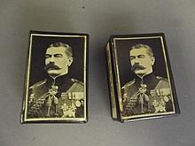 A pair of early C20th enamel matchbox holders in memoriam of Lord Kitchener, 2¼'' x 1½''