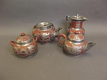 Four pieces of Yixing tea ware with overlaid pewter decoration depicting dragons, 6½'' high