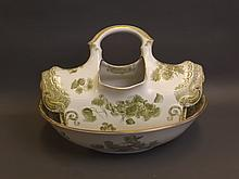 A large C19th rare Doulton jug and basin set of unusual shape, with scrolling foliate decoration, basin 18'' x 12¾'' (AF)