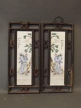 A pair of Chinese porcelain plaques with enamel decoration of a gentleman making a libation to the moon, in pierced and carved hardwood frames, 10¼'' x 22¾''