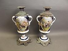 A pair of C19th Paris porcelain metal mounted twin handled oil lamp bases painted with figures, 17'' high