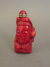 A Chinese red coral scent bottle carved in the form of Quan Yin's head, 2¾'' high