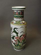 A Chinese famille verte vase with painted enamel decoration of finches and grasshoppers amongst plants, 6 character mark, 11'' high
