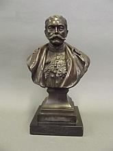 An early C20th bronze bust of Lord Kitchener by Richard Claude Belt, signed and dated 1916, 10½'' high