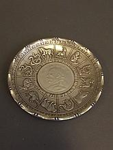 A Chinese silvered metal coin dish decorated with relief zodiac animals, marked 'Wai Kee 90 Silver' verso, 3¾'' diameter