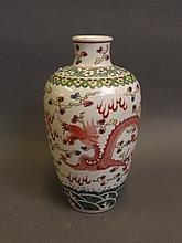 A Chinese famille verre style porcelain vase decorated with two dragons chasing the flaming pearl, 6 character mark, 8½'' high