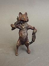 A cold painted bronze figure of a fox with a rifle and dead pheasant, impressed 'B', 2¼'' high