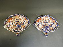 A pair of fan shaped porcelain dishes decorated in the Imari palette