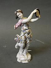 A Continental porcelain figure of a dancing girl with tambourine, crossed swords mark to base, 8'' high