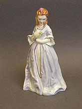 A Royal Worcester porcelain figure 'Sweet Annie' 3630 modelled by F.G. Doughty, 7½'' high