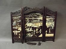 A Chinese carved hardwood 3 fold table screen decorated with stained and carved ivory depicting figures and pavilions (AF), 27'' x 30''