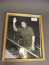 An original framed photo of Muhammad Ali boarding a plane, 10½'' x 8¾''