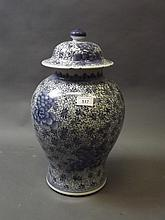 A Chinese blue and white porcelain jar and cover, possibly late C19th/early C20th, 17½'' high (AF chips to rim of lid)