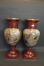 A pair of large Vienna style pottery vases painted with elegant figures in a garden setting, 27'' high