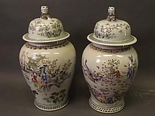 A pair of large Chinese vases and covers with polychrome enamel decoration depicting the Eight Immortals above the clouds, with figures in garden and riverscape scenes, 23½'' high
