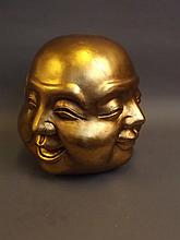 A large gilt composition four faced Buddha, 10'' high