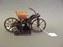 A Franklin Mint die cast model of an 1885 Daimler motorcycle, with original box, 8½'' wide