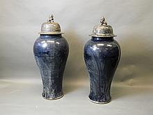 A pair of blue glazed large Chinese temple vases with black glazed lids and lion dog knops, 45'' high
