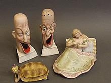 Two Bisque ugly men cigarette holders, a turtle girl trinket box, and another risque group, 5'' high