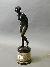 Eugene Wagner, a fine Art Deco patinated bronze figure of a female nude, standing on a marble base, 14'' high