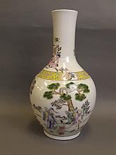 A large Chinese porcelain vase with polychrome enamel decoration depicting figures in a landscape and a phoenix, 6 character mark, 16½'' high