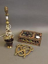 An unusual inkwell and side compartment decorated with chinoiserie designs, a brass trivet in the form of 'George Washington Cypher', a brass candlestick transformed into a lamp, and a C19th Indian brass figure holding a child
