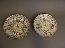 A pair of C18th Chinese famille rose armorial dishes painted in coloured enamels with figures etc, 6¼'' diameter