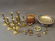 A quantity of brass ware to include Georgian candlesticks, door knockers, stem vase etc