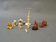 A quantity of ivory, bone and hardwood netsuke carved in various forms to include chickens, father and child, goats, musicians etc, largest 5½'' long
