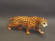 A glazed Beswick figure of a jaguar, 11¼'' long