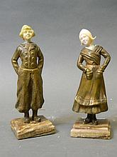 A pair of C19th Continental gilt bronze and ivory figures of a Dutch boy and girls, standing on marble bases, 6½'' high