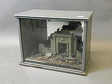 A cased WWII themed diorama with Tamia figures depicting German soldiers defending a military building, 18'' x 10'', 13½'' high (AF)