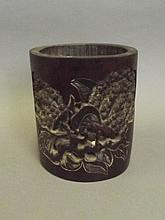 A Chinese bamboo brushpot with carved and pierced sides depicting a fruiting tree, character inscription verso, 7'' high