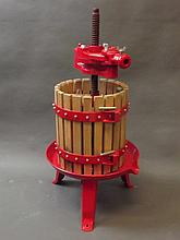 A metal and wood fruit press, 28'' high