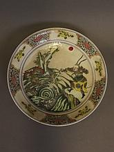 A Chinese fan verte dish with painted enamel decoration of a warrior fighting a sea dragon, 9¼'' diameter