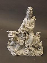 A blanc-de-chine figure of Quan Yin riding a kylin, impressed mark verso, 16¼'' x 14''