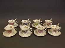 A set of eight Royal Stratford 'Tea with the Queen Mother' cups and saucers with teaspoons, (1 teaspoon missing)