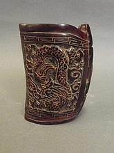 A Chinese carved horn cup decorated with a phoenix
