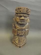 An Eastern carved wood Tokem figure, 12