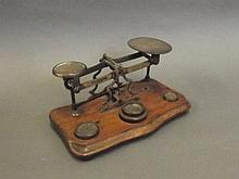 A set of brass postal scales with four weights by