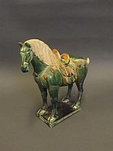 A Chinese terracotta Tang style horse with a green